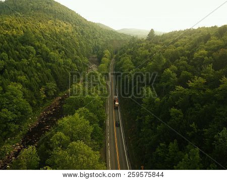 Aerial Drone View Of Foggy Highway / Road In The Adirondack Mountains Of Upstate New York. Morning C