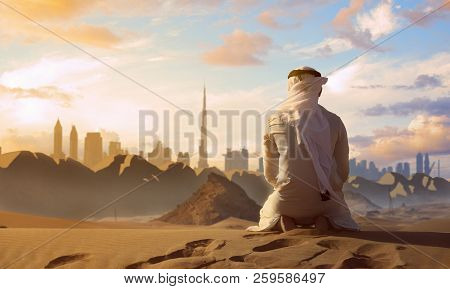 Arab Man Standing Front Dubai Skyline In The Desert Of Uae