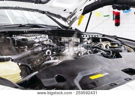 Car detailing. Car washing cleaning engine. Cleaning car using steam. Steam engine washing. Soft lighting. poster
