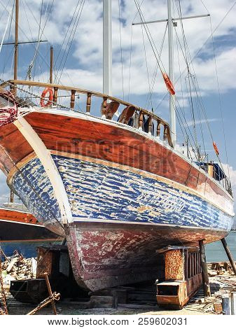 Repair Of A Large Yacht On The Shore Without A Dock