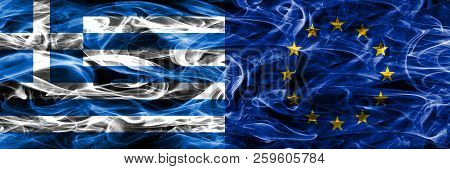 Greece Vs European Union Smoke Flags Placed Side By Side. Thick Colored Silky Smoke Flags Of Greek A