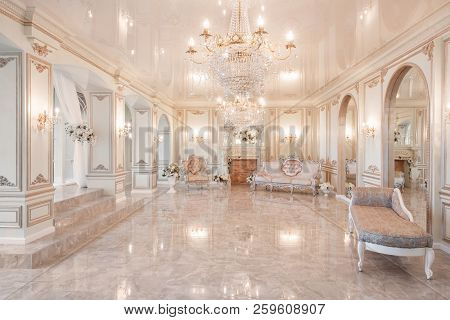 Daylight In The Interior And Light Of Electric Lamps. Morning In Luxurious Light Interior In Mansion