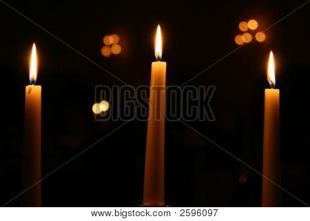 Three Candles Burning At Night