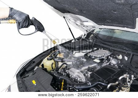 Car Detailing. Manual Car Wash Engine With Pressurized Water. Washing Car Engine With Water Nozzle.