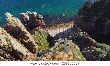 Dramatic View Of The Steep Rocky Cliff In The Sea. Amazing View Of The Blue Sea And Rocky Shore, Dro