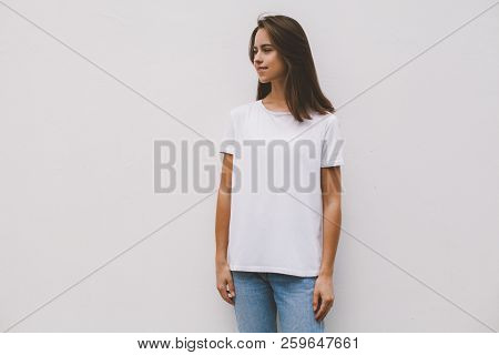 Young Hipster Smiling Girl Wearing Blank White T-shirt And Blue Jeans, Mock-up Of Blank White T-shir