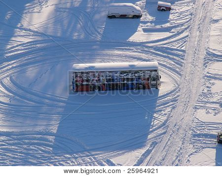 Aerial view of bus in heavy snow