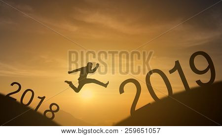 Brave Man Successful Concept,silhouette Man Jumping Over The Sun Between Gap Of The Mountain From 20