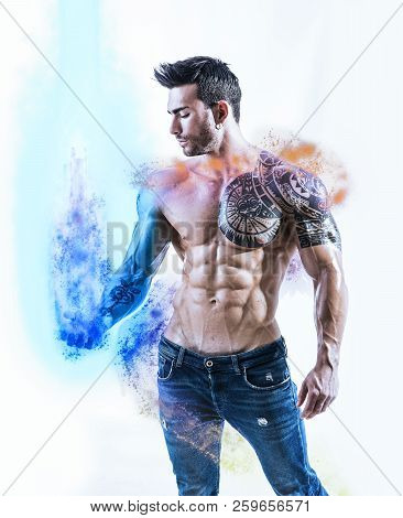 Tattooed Powerful Muscular Man With Energy Ball In Hand