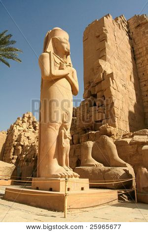 Colossal statue of pharaoh found broken in the court. The royal name carved on his belt mentions Paynedjem (21st Dyn.). However, the original owner of the statue was Ramsses II or an even earlier king