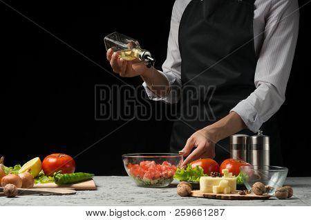 Freezer Food Prepare In Process Vegetarian Salad By Chef Hand In Home Kitchen. Dark Black Background