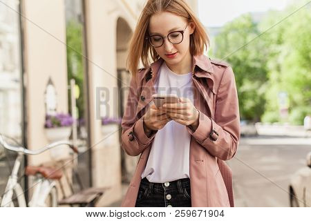 Happy Smiling Businesswoman Using Modern Smartphone Device, Successful Female Entrepreneur Using Cel