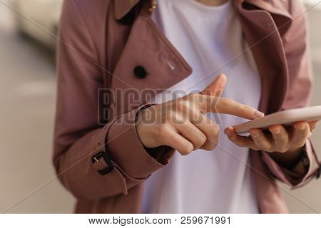 Cropped Shot Of Young Girl Using Modern Smartphone Device, Female Hands Holding Mobile Phone On City