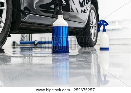 poster of Cars in a carwash. Car wash with foam in car wash station. Carwash. Washing machine at the station. Car washing concept. Car detailing