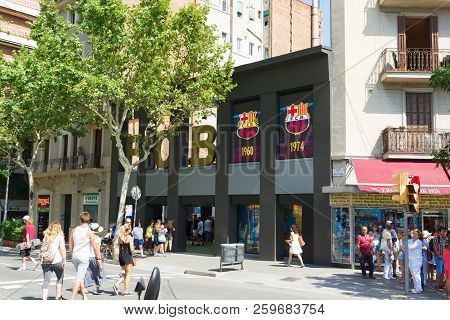 Barcelona, Spain - August 17, 2017: The Streets Of Barcelona With Walking Tourists. Bar Of The Footb