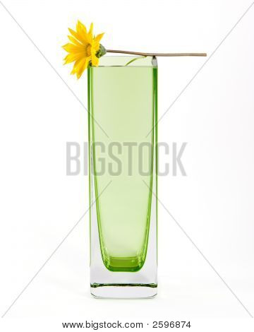 Yellow Flower In A Simple Green Glass Vase