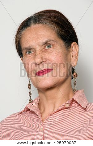 The elderly woman on a light background.Portrait