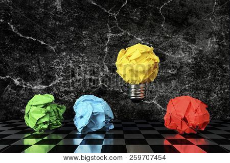 Crumpled Paper Light Bulb Above Other Crumpled Paper Balls, Idea Or Different Concept