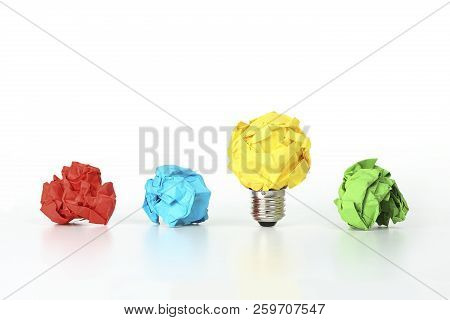 Crumpled Paper Light Bulb Among Other Crumpled Paper Balls, Idea Or Different Concept