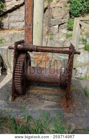 Machinery Of An Old Manual Crane Already Rusted And In Disuse, Used To Hoist The Boats To The Mainla