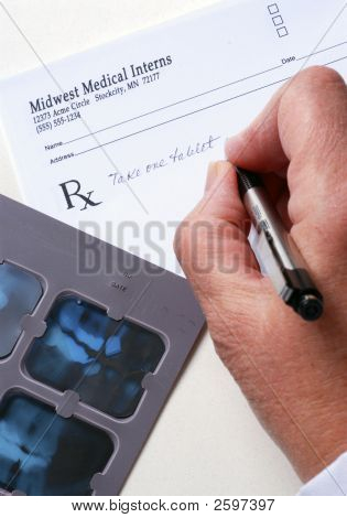 Dentist Writing A Prescription For The Patient