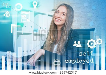 Smiling Young Woman With Fair Hair Sitting In Her Office With Glowing Self Employed Text And Icons A