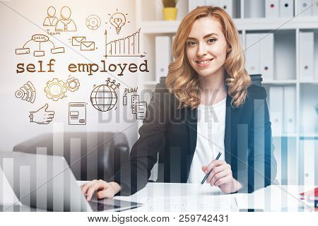 Charming Red Haired Woman Sitting In Office Near A Self Employed Text And Icons Drawing. Graphs In T