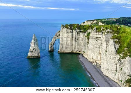 Etretat, Normandy, France. Cliffs Aval And Needle With Beautiful Famous Coastline During The Tide At