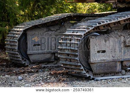 Industrial Implement Steel Metal Wheel Tracks On Dirt