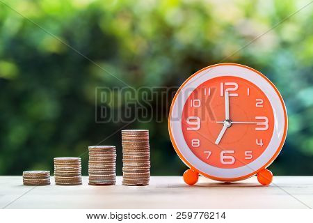Use Money Investment To Save Time And Resources Concept. Stacking Coins In 1 To 4 Step With White Or