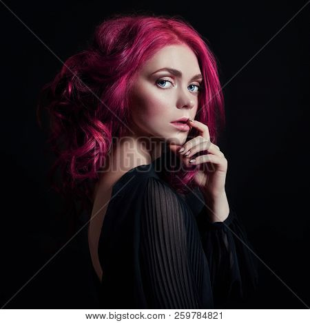 Portrait Of A Woman With Bright Colored Flying Hair, All Shades Of Pink. Hair Coloring, Beautiful Li