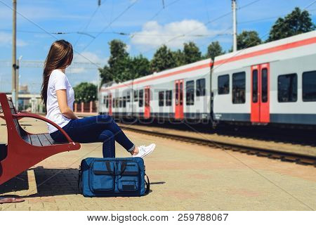 Traveller Girl With Travel Bag At Train Station Travel And Transportation Concept