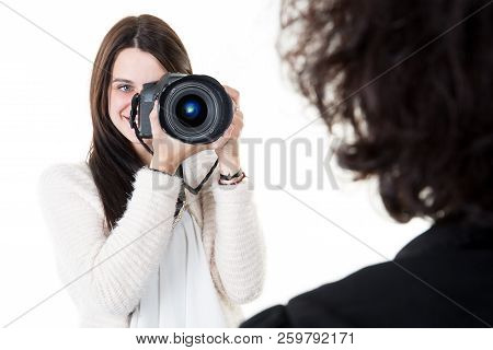 Female Photographer Taking Pictures Portrait Of Woman