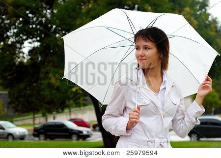 Young woman with umbrella portrait.