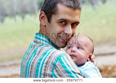 The father with the newborn son in park