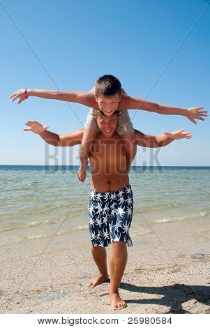 Joyful brothers having fun at the beach