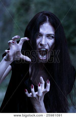 Portrait vampire at a moonlight