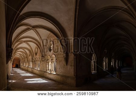 Alcobaca, Portugal - July 17, 2017: Collonade of the Dom Dinis Cloister in Monastery of Alcobaca Abbey, a masterpiece of the Medieval Gothic architecture. Cistercian Religious Order