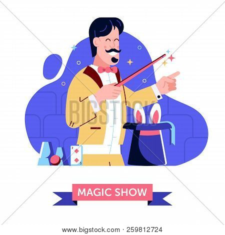 Magician In Stage Suit Shows Focus With Magic Hat And Rabbit. Smiling Circus Illusionist Holding Wan