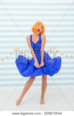 Happy Retro Woman With Crazy Look Hold Windy Dress. Crazy Girl With Happy Face And Orange Hair. Pin