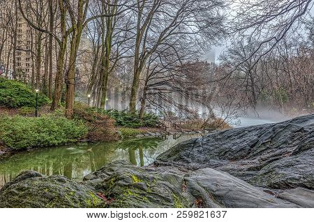 At The Lake In Central Park, New York City Very Foggy On Winter Day