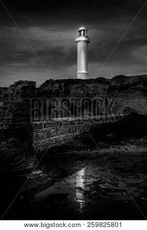 Wollongong Lighthouse With Reflections In Tidal Rock Shelf.