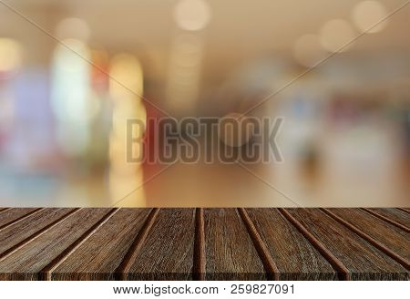 Empty Perspective Wood Plank Table Top With Abstract Bokeh Light Background For Montage Of Your Prod