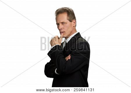 Thinking Businessman With Finger On Chin. Serious Middle-aged Entrepreneur Looking Thoughtful, Isola