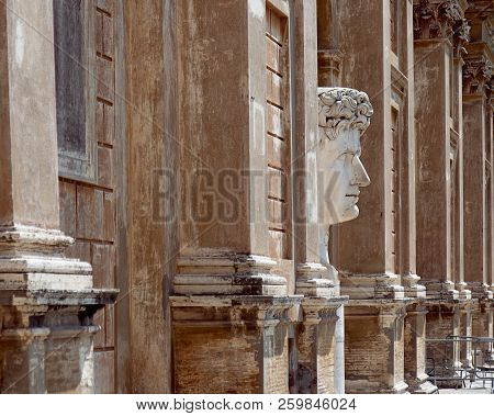 A Big Marble Head Statue Of Emperor Caesar Augustus In The Courtyard Of The Pine In The Vatican Rome