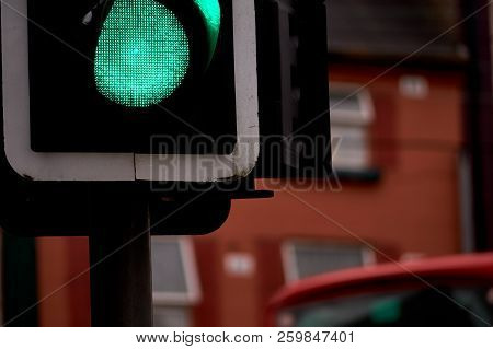 Town Traffic Lights, Green Light On - Focus On Foreground.