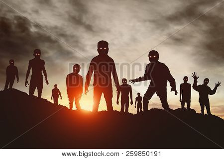 Group Of Zombies Attack At Sunset Silhouette