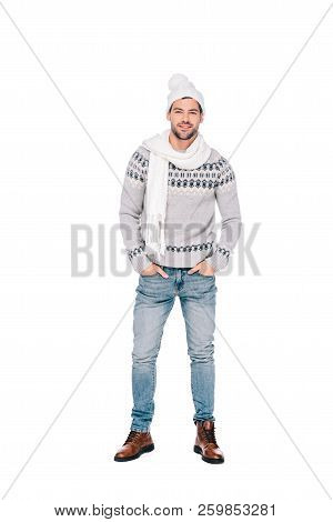 Full Length View Of Handsome Young Man In Sweater, Scarf And Hat Standing With Hands In Pockets And