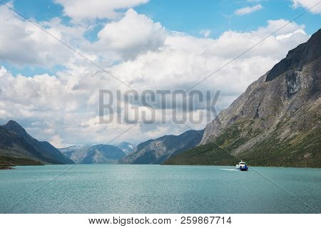 Landscape With Besseggen Ridge Over Gjende Lake With Ship In Jotunheimen National Park, Norway