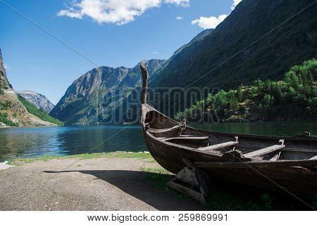 Boat Near Lake And Mountains In Gudvangen, Neirofjord, Norway